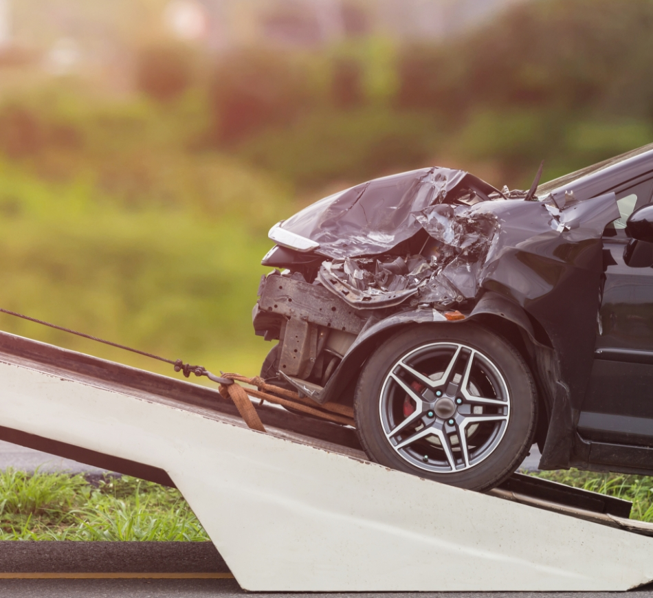 front-of-black-car-get-damaged-by-accident-on-the-road
